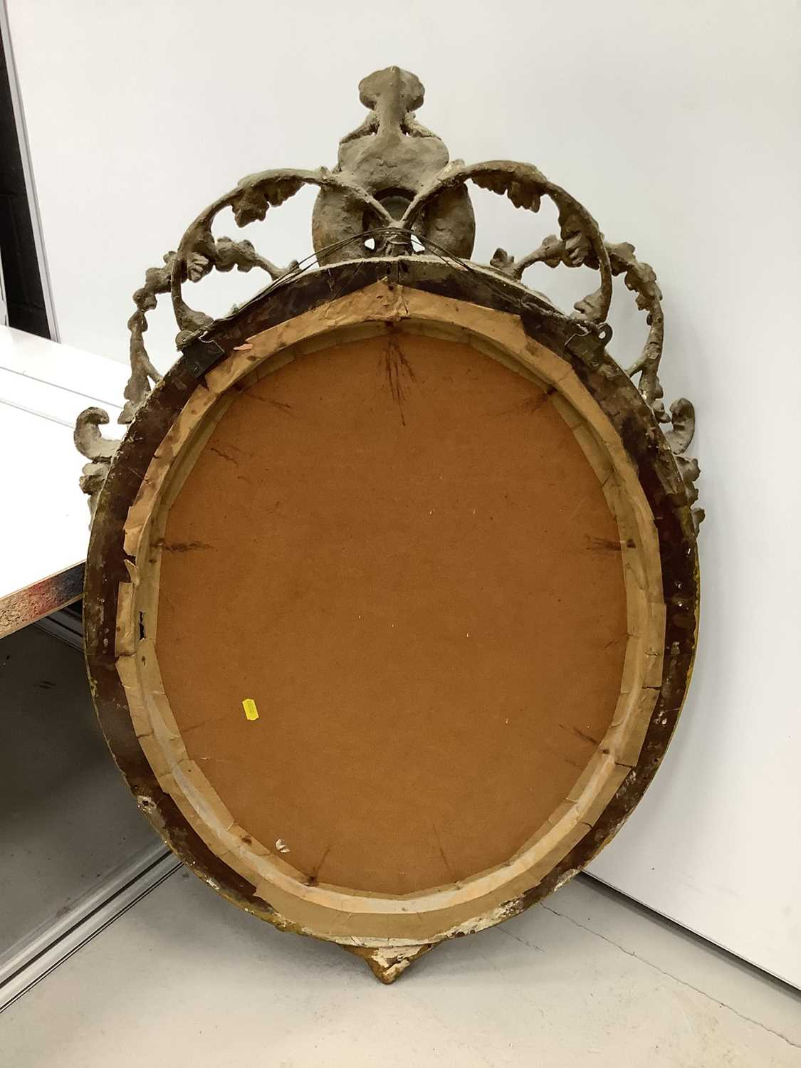 Oval wall mirror in green and gilt frame with cherub mount, 100cm x 61cm - Image 2 of 5