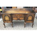 Good quality walnut sideboard with raised ledge back, two central drawers below flanked by cupboards