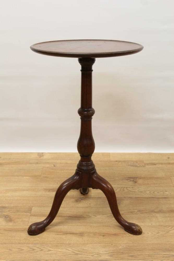 George III mahogany tripod wine table, with circular top on turned and shaped column and three splay