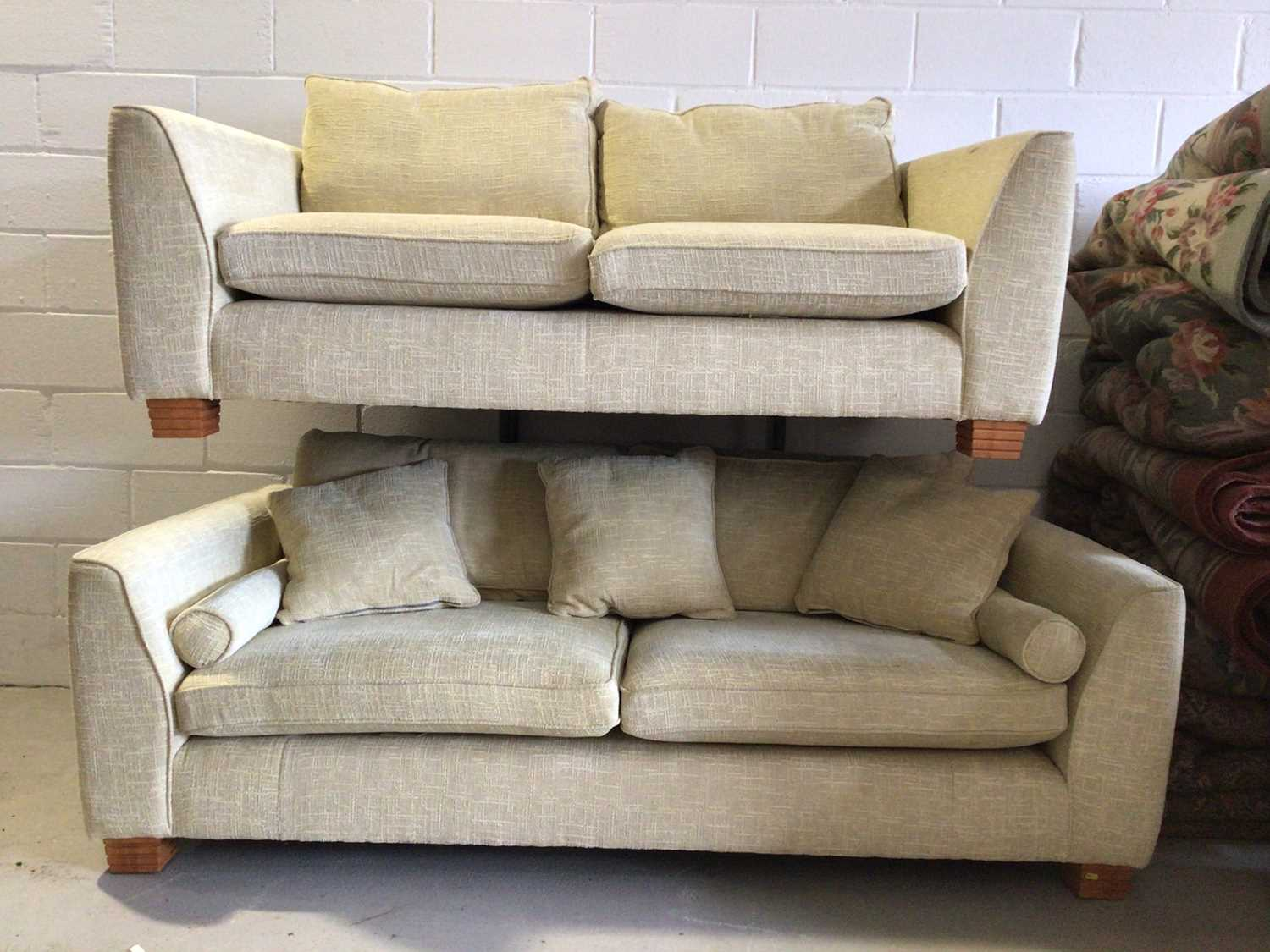 Contemporary three piece suite with pale yellow upholstery comprising a pair of two seater settees 2
