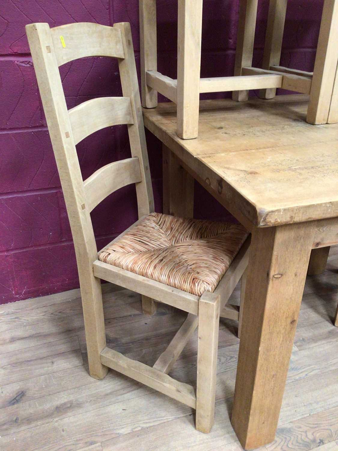 Contemporary light oak dining table and four matching ladder back chairs with rush seats - Image 3 of 5