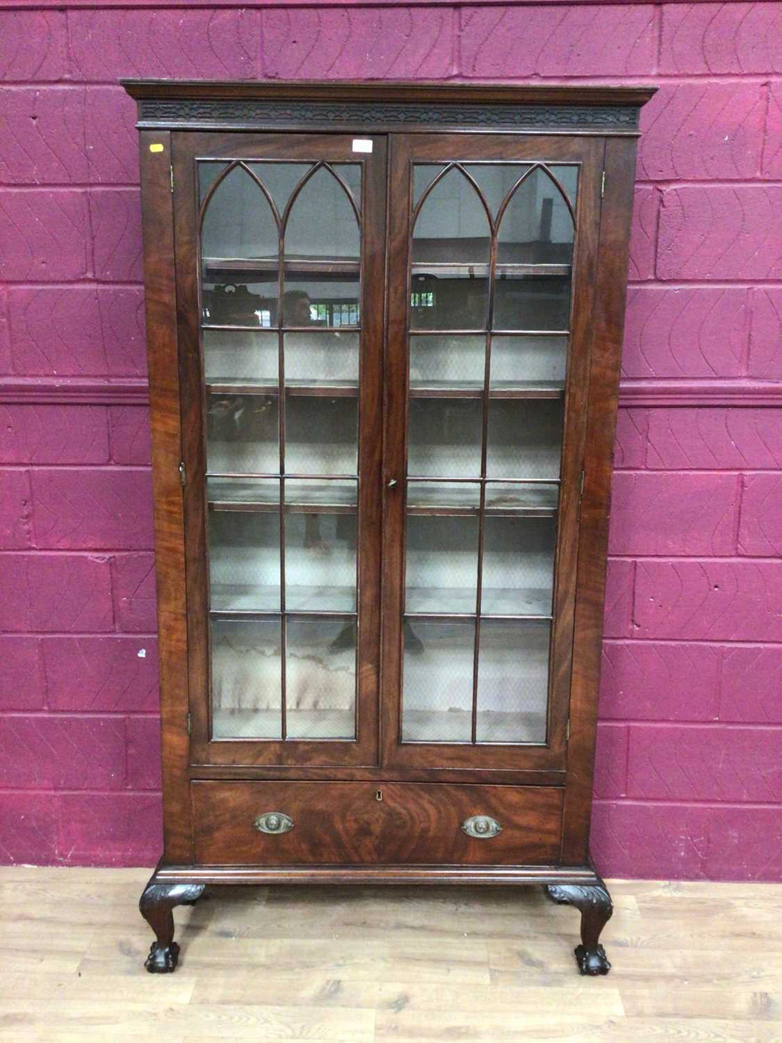 Edwardian mahogany bookcase with shelved interior enclosed by two glazed doors with drawer below on