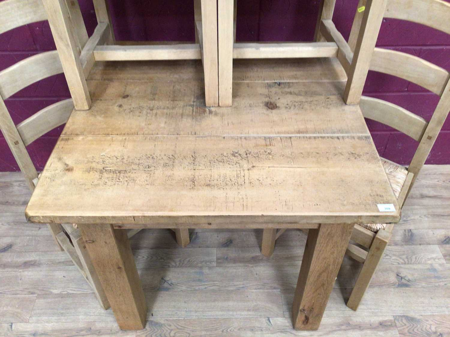 Contemporary light oak dining table and four matching ladder back chairs with rush seats - Image 5 of 5