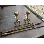 Pair brass fire dogs and brass fire irons