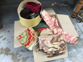 An assortment of needlework and tapestry cushion covers and a similar bedspread, together with a rol
