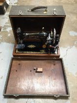Two cased sewing machines, including a Singer and an Ideal Vollzickzack