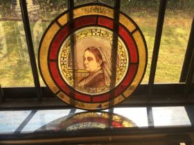 Victorian stained glass circular panel, painted depicting a portrait of Queen Victoria, dated 1887,