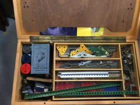 Selection of Meccano in wooden fitted box including boxed electric motor, gears, wheels, pulleys etc