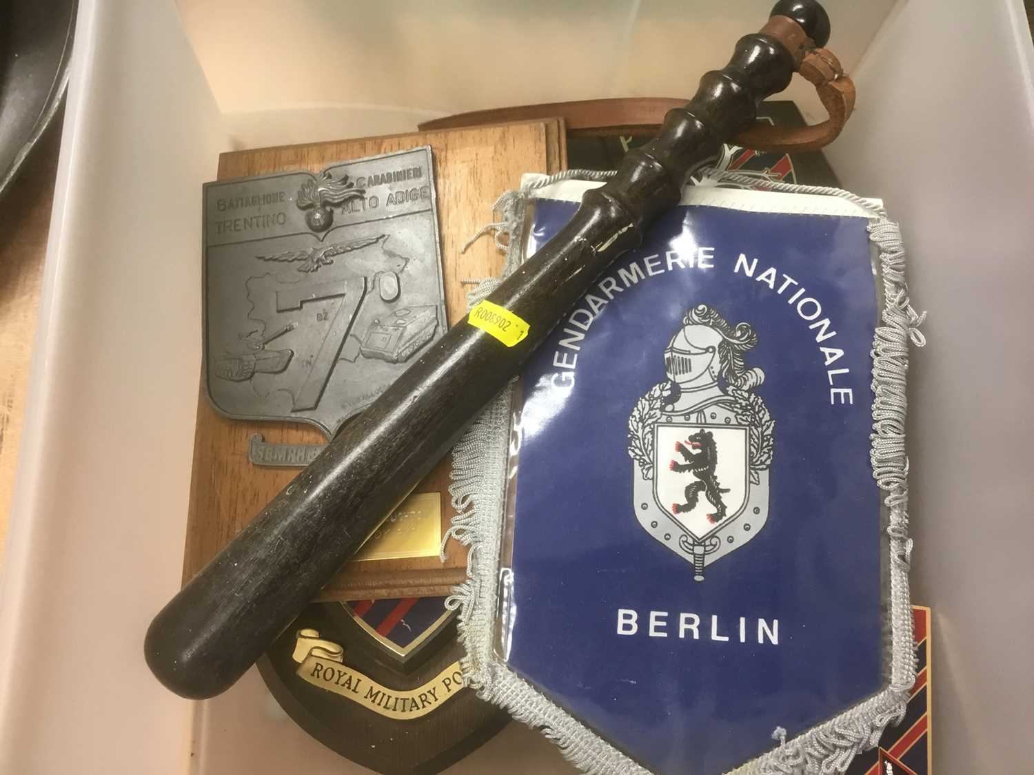 Vintage truncheon together with a group of regimental crests / plaques