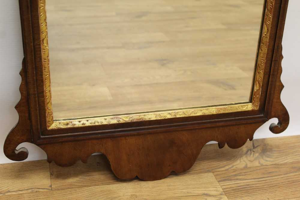 George II style mahogany fret carved wall mirror, the pierced carved top centred with a gilt floral - Image 3 of 4