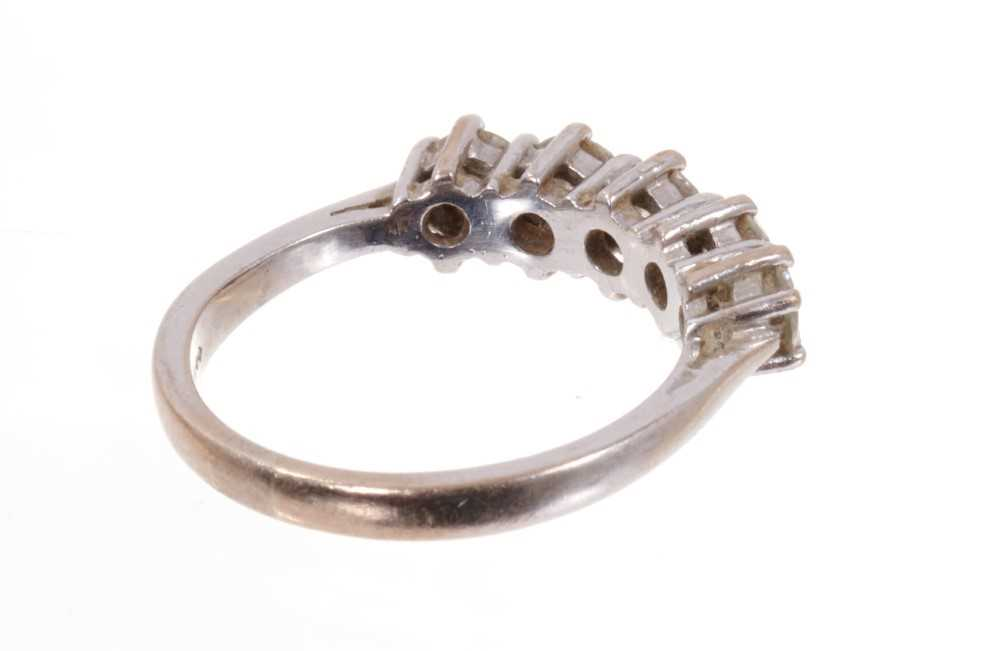 Diamond five stone ring with five brilliant cut diamonds in claw setting on 18ct white gold shank. E - Image 3 of 3
