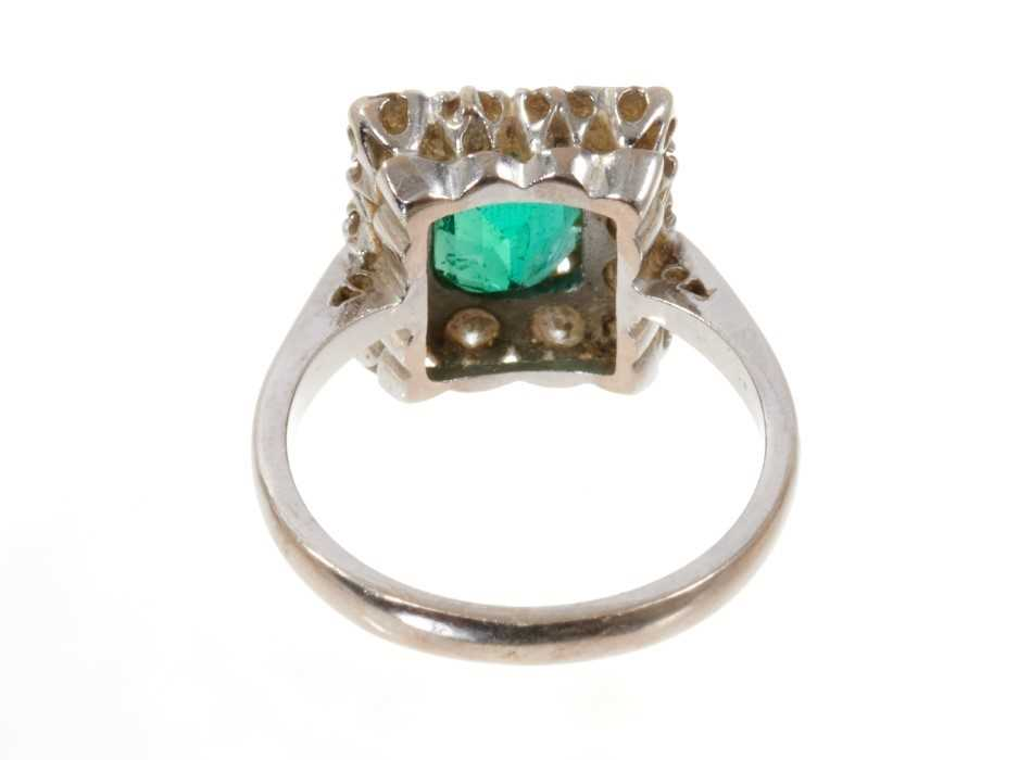 Emerald and diamond cluster ring with a rectangular step cut emerald surrounded by a border of fourt - Image 3 of 3