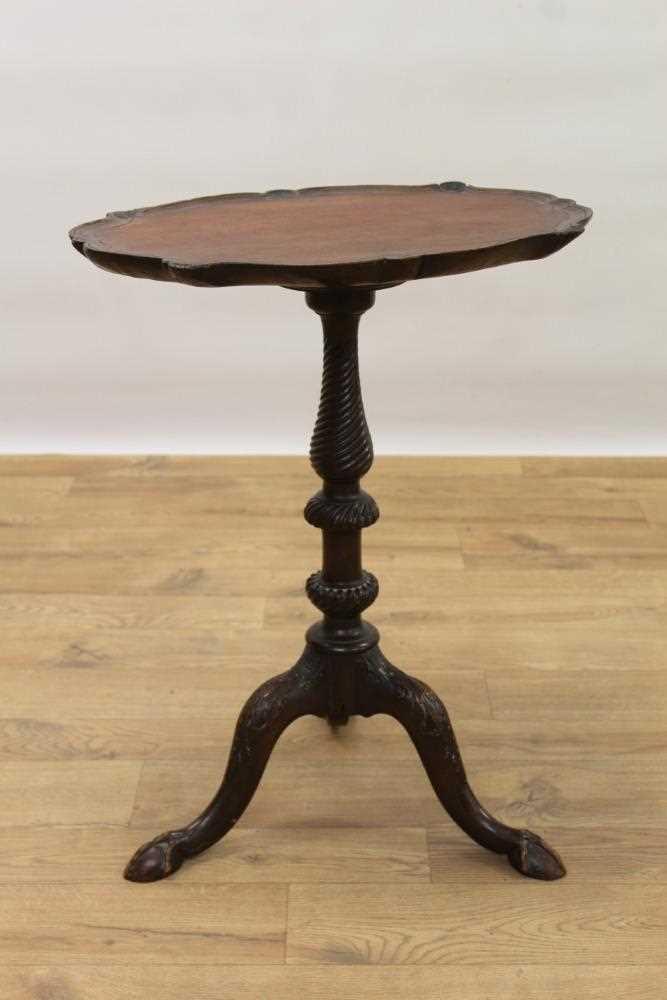 Edwardian carved mahogany tripod wine table