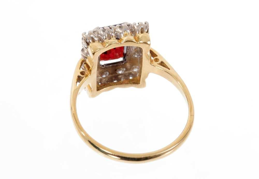 Garnet and diamond cluster ring with a rectangular step cut garnet surrounded by a border of single - Image 3 of 3