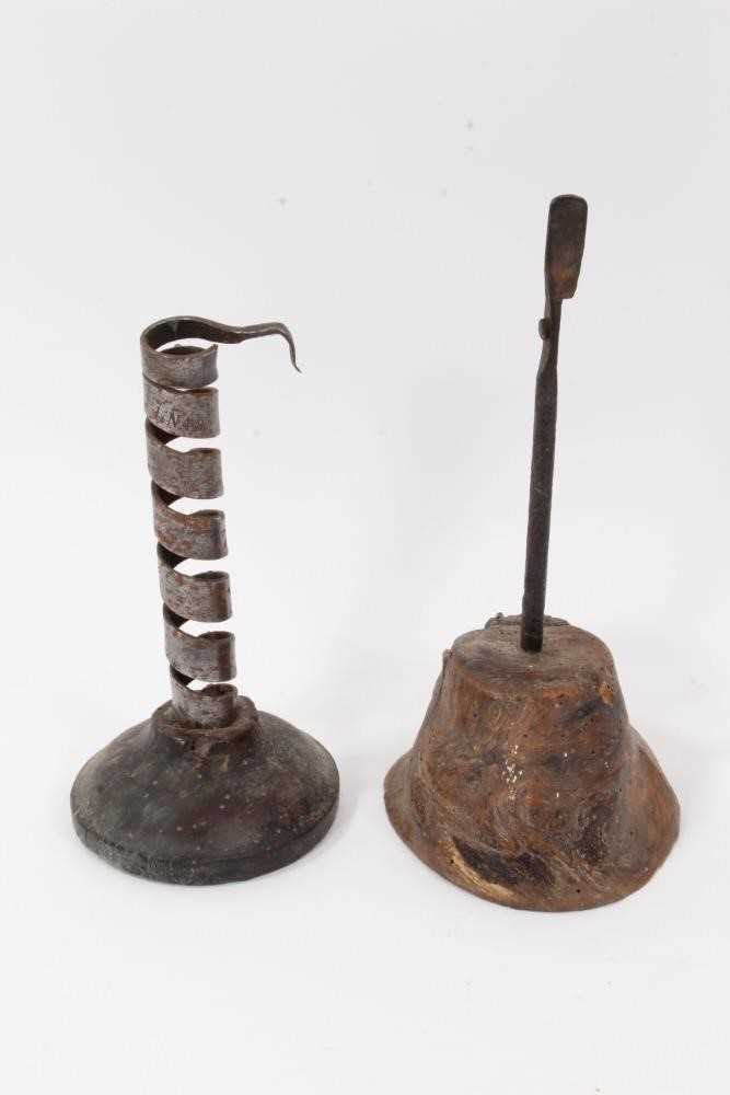 18th century steel spiral candlestick, together with a rush light, partially incomplete