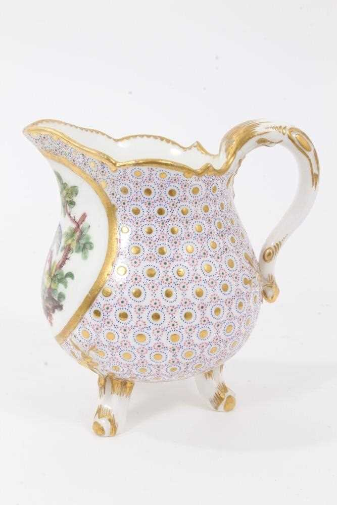 Sèvres milk jug, circa 1770, probably painted by Evans, with scalloped rim and standing on three fee - Image 2 of 9