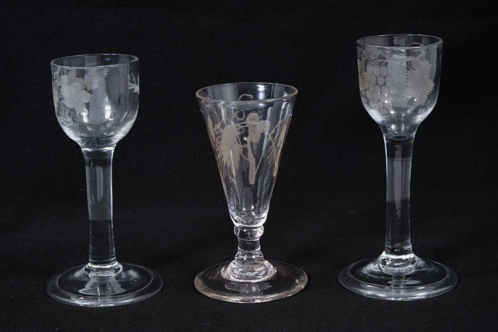 Three Georgian wine glasses, with etched ogee, ovoid and trumpet bowls, between 12cm and 14.5cm high