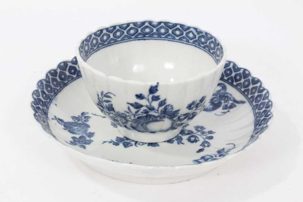Caughley tea bowl and saucer, circa 1780, of fluted form, printed in blue with the 'Apple' pattern,