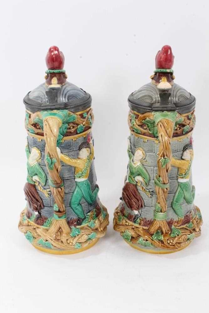 A matched pair of Minton Majolica 'Tower' jugs, 1881 and 1883, 33cm height - Image 4 of 8