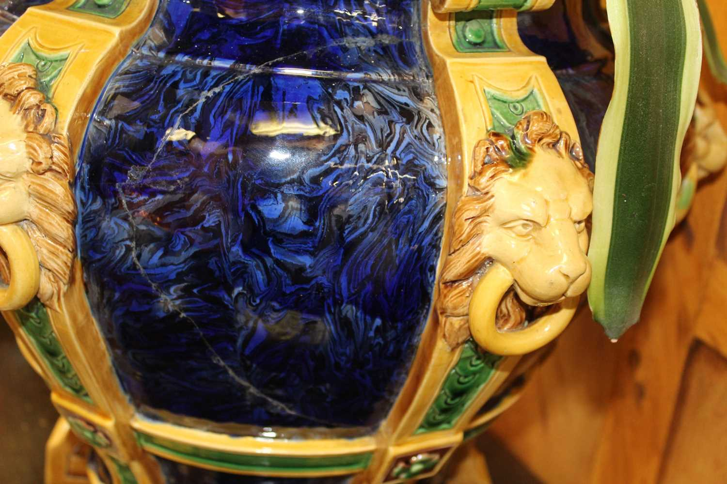 Large 19th century English majolica jardinière, decorated in relief with lion masks and paw feet on - Image 2 of 5