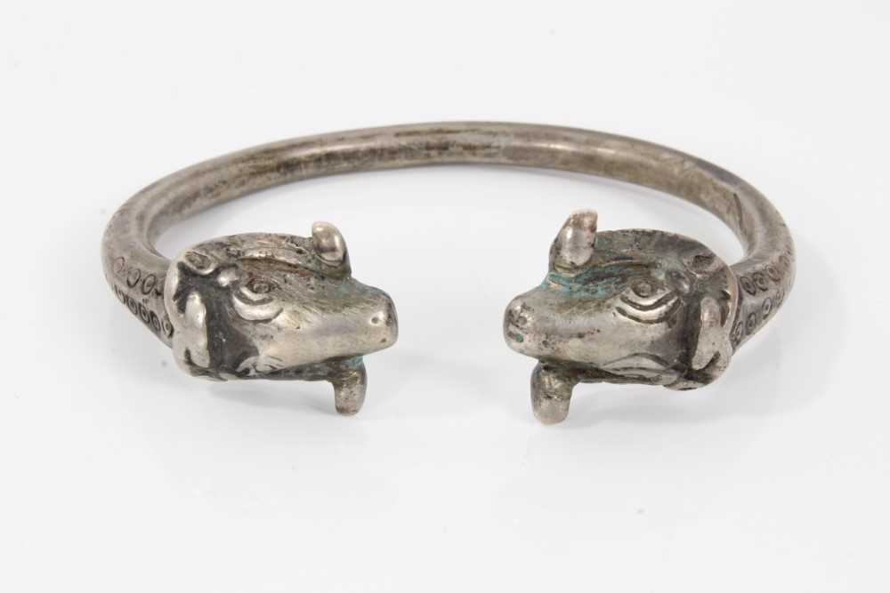 Persian silver/white metal torque bangle with rams head terminals