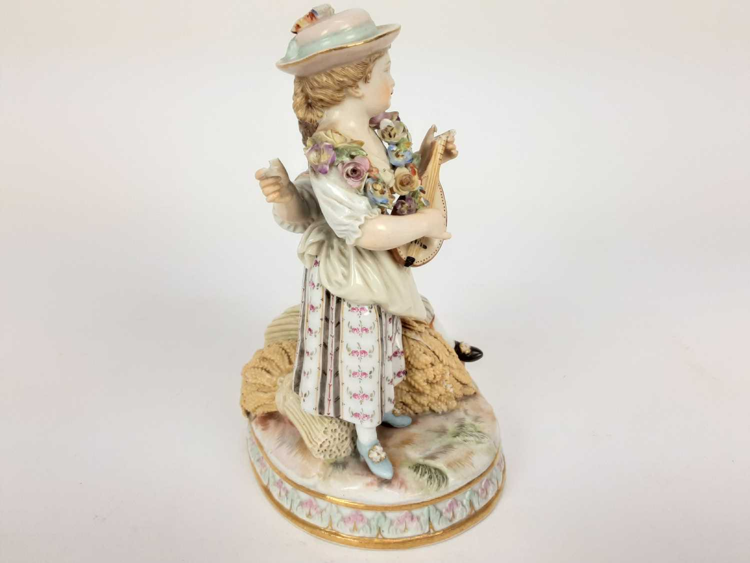 Meissen porcelain group, late 19th century, the boy sat on a sheaf of wheat, listening to a girl pla - Image 2 of 9