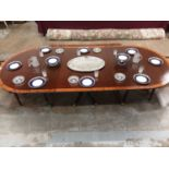 George III style mahogany crossbanded triple pedestal dining table, on spread supports and brass cap