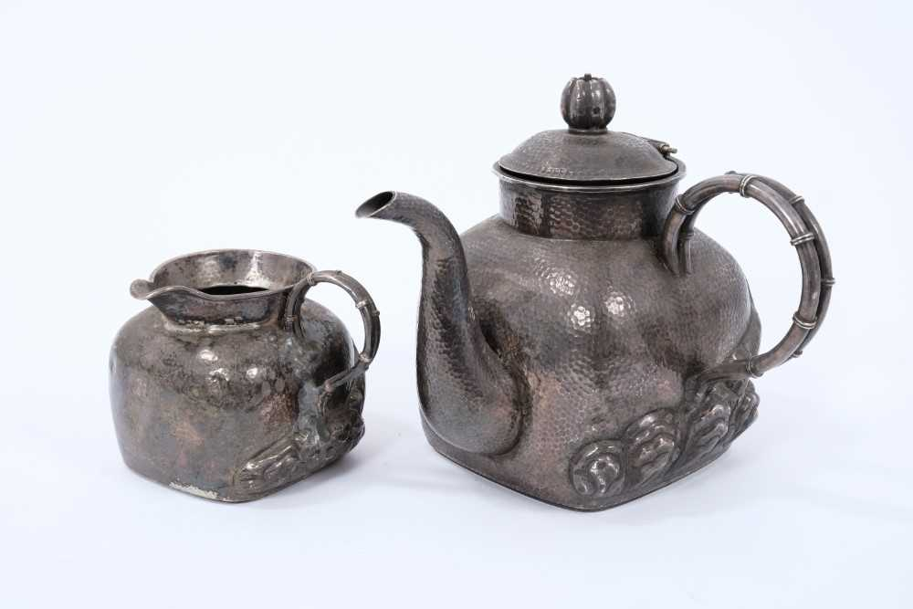Chinese silver teapot and jug