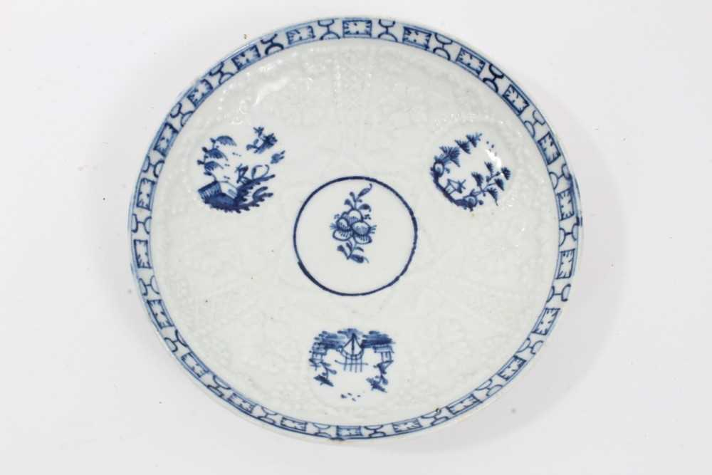 Lowestoft blue and white saucer, circa 1765, relief moulded, with circular panels containing Chinese