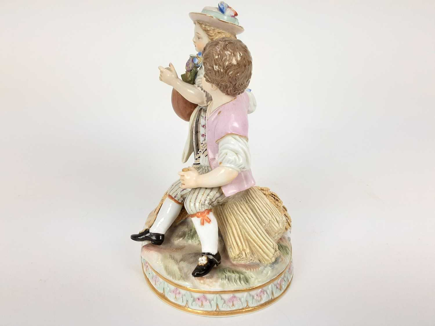 Meissen porcelain group, late 19th century, the boy sat on a sheaf of wheat, listening to a girl pla - Image 4 of 9