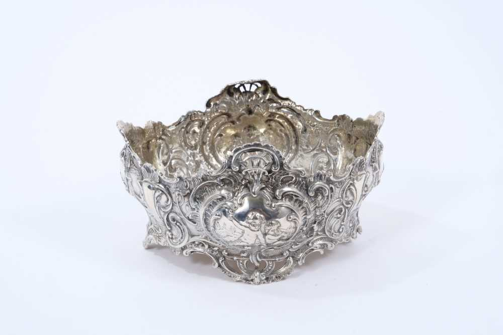 Late 19th century Dutch silver bowl of oval form, with embossed foliate scroll decoration and panels