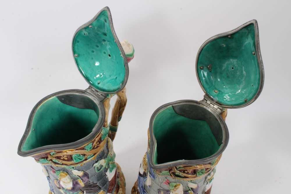 A matched pair of Minton Majolica 'Tower' jugs, 1881 and 1883, 33cm height - Image 6 of 8