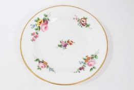 Nantgarw plate, circa 1817-20, polychrome painted with flowers with gilt rim, impressed mark to base