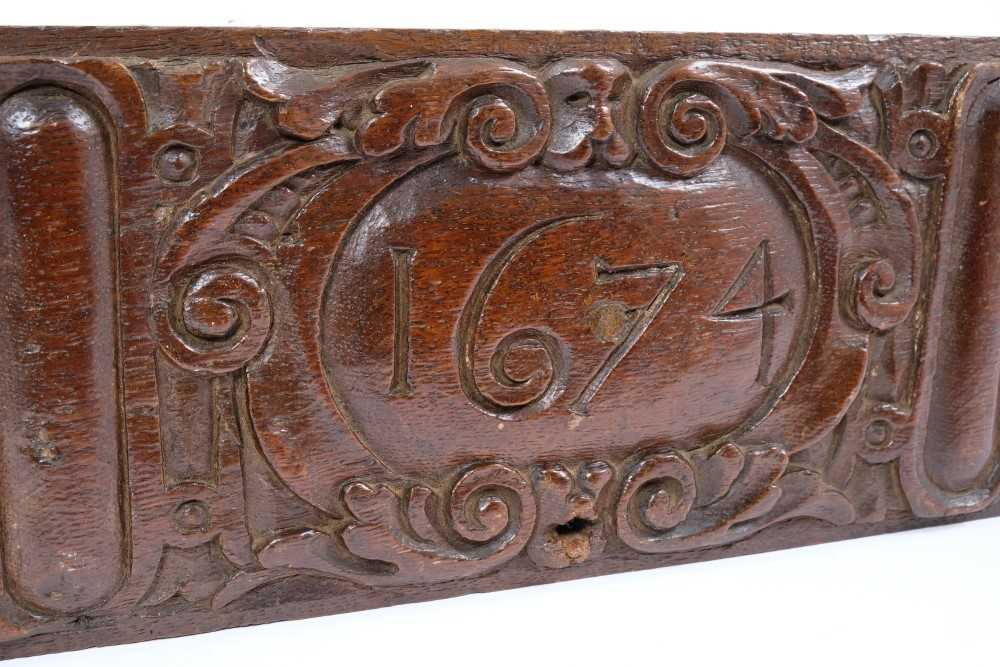 17th century carved oak plaque, dated 1674, 39cm long - Image 2 of 2