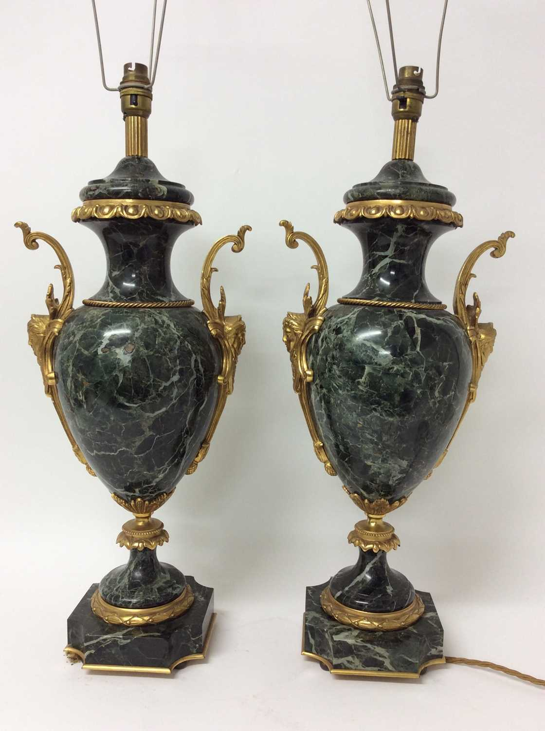 Pair of 18th century style gilt metal mounted verde antico marble table lamps, each of urn form with
