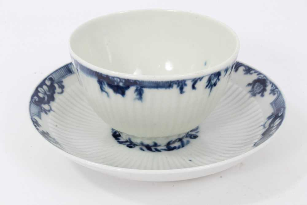 Worcester blue and white fluted tea bowl and saucer, circa 1760, decorated with patterned borders, t