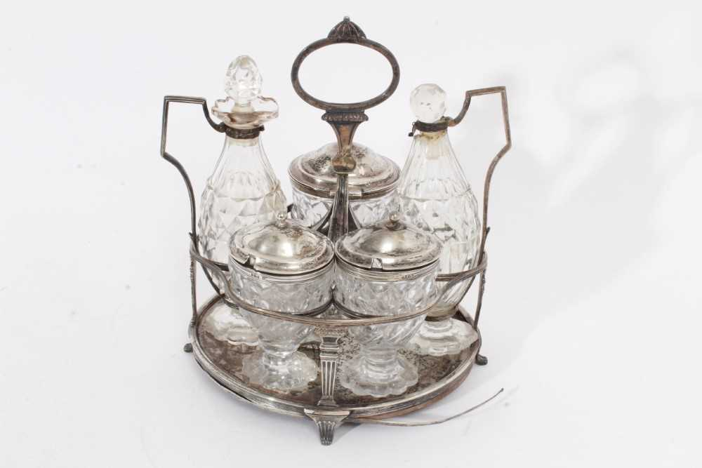 George III silver cruet stand with five matching bottles