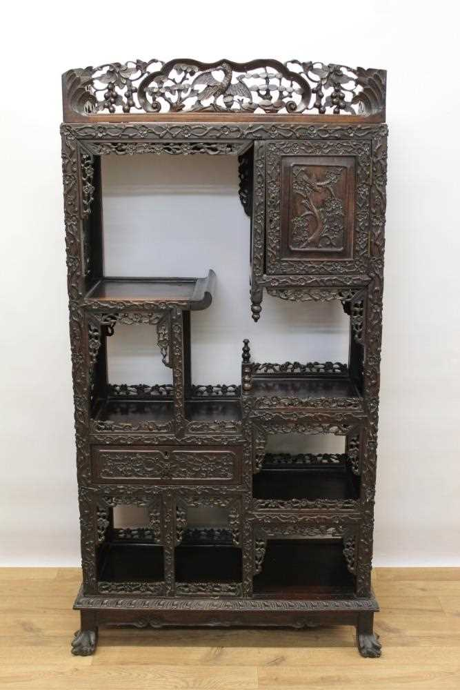 Late 19th century Chinese carved rosewood display cabinet
