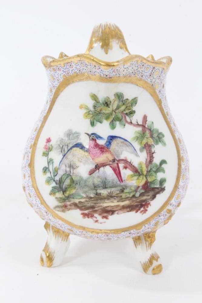 Sèvres milk jug, circa 1770, probably painted by Evans, with scalloped rim and standing on three fee