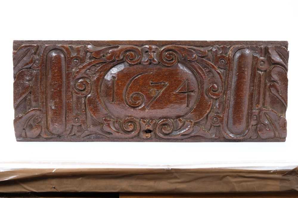 17th century carved oak plaque, dated 1674, 39cm long