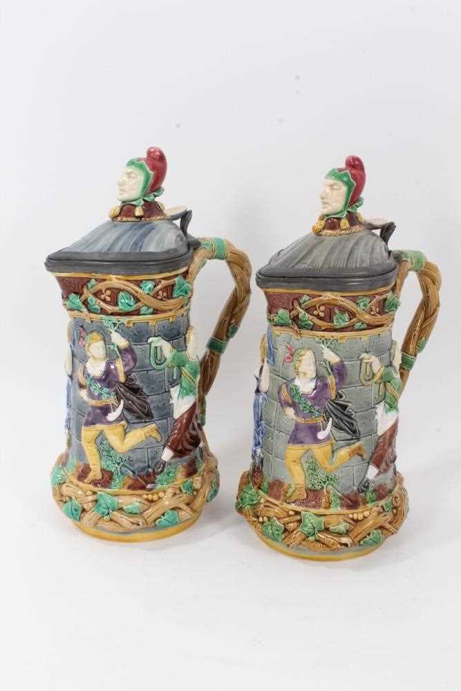 A matched pair of Minton Majolica 'Tower' jugs, 1881 and 1883, 33cm height