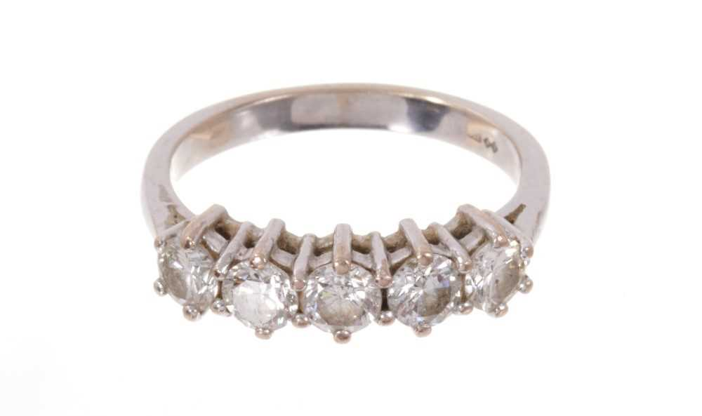 Diamond five stone ring with five brilliant cut diamonds in claw setting on 18ct white gold shank. E