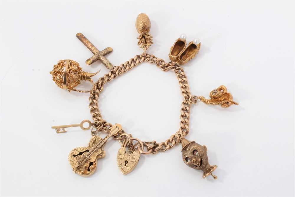 9ct gold charm bracelet with eight 9ct gold charms and padlock clasp,