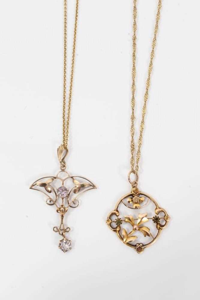Two Edwardian gold and gem set pendants with openwork floral plaques on chains