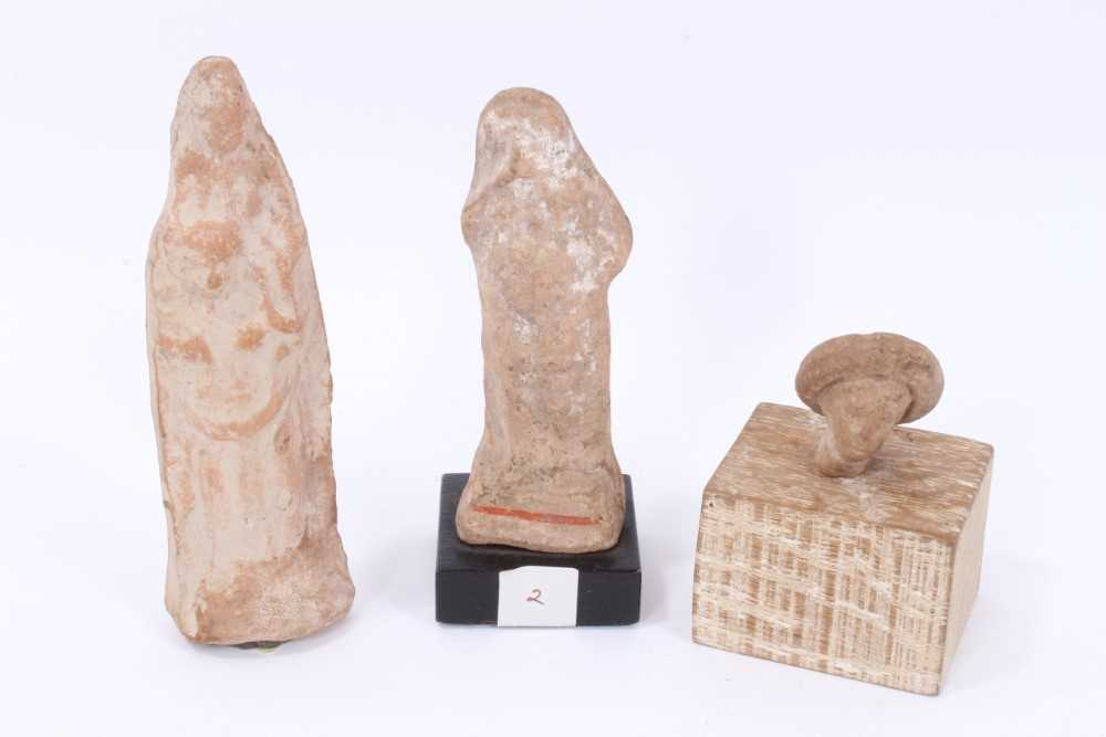 Two Tanagra terracotta figures together with a Tanagra head fragment