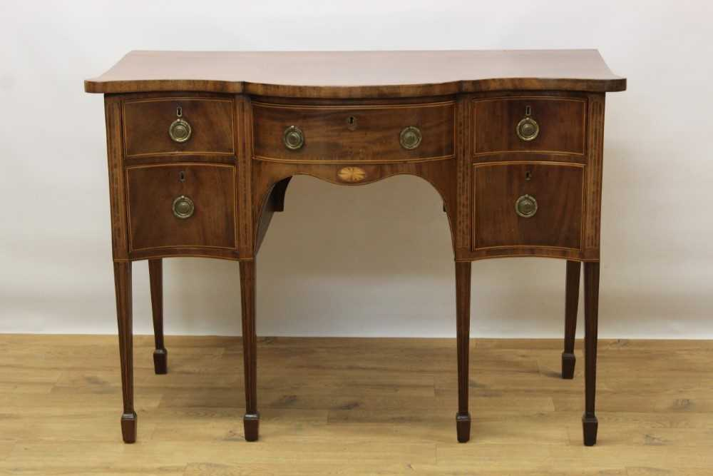 George III mahogany and satinwood banded serpentine sideboard of small proportions