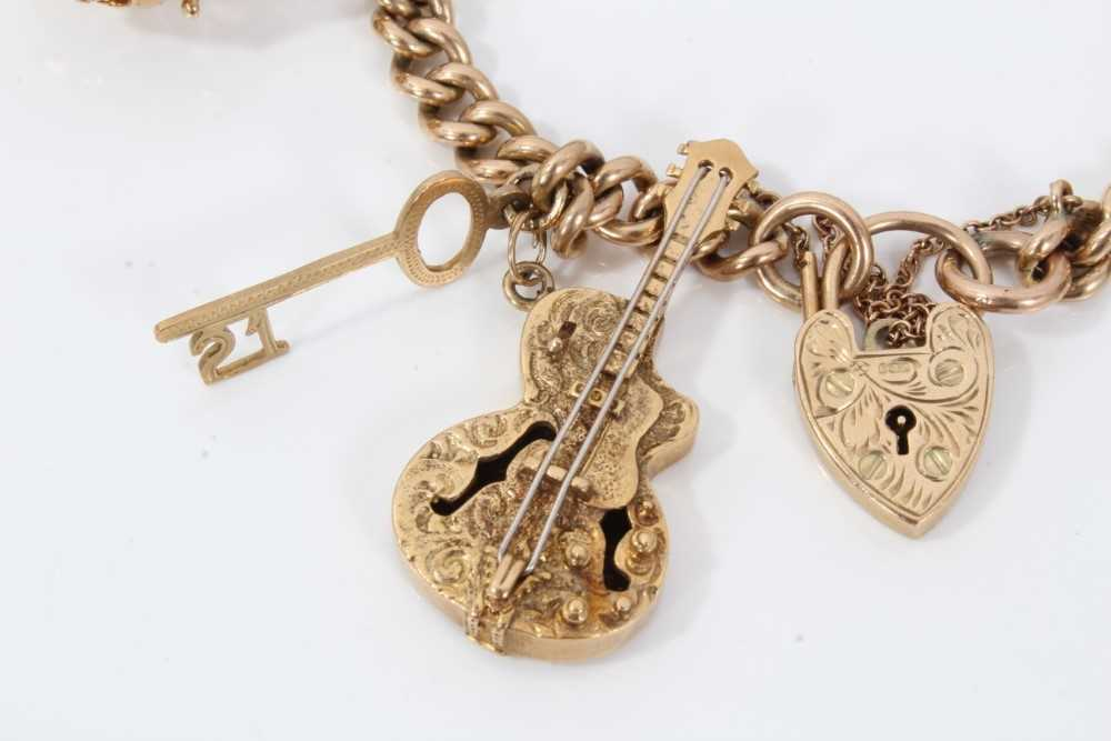 9ct gold charm bracelet with eight 9ct gold charms and padlock clasp, - Image 2 of 5