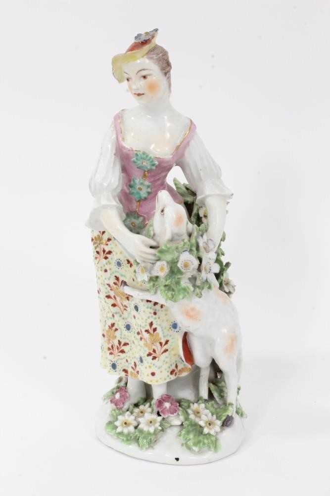 Derby figure of a shepherdess, circa 1760-65, polychrome and gilt decorated, shown garlanding a lamb