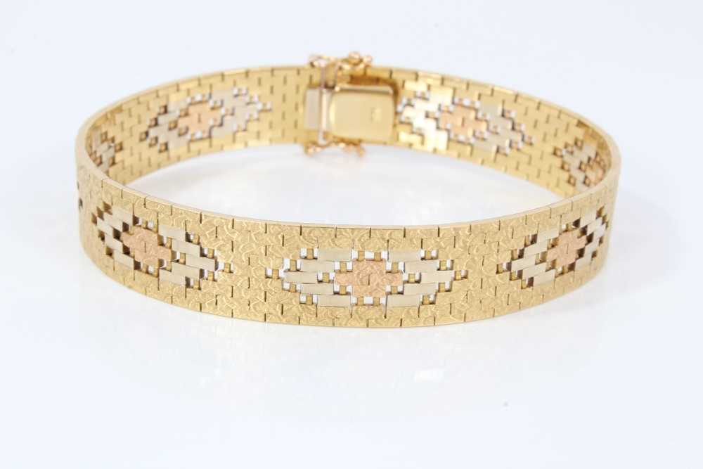 Three-colour 18ct gold bracelet with articulated fancy links