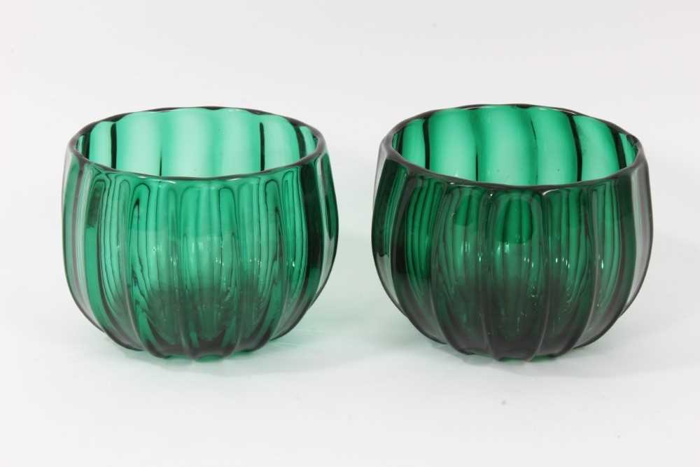 Pair of green glass finger bowls, early 19th century, of moulded round shape with polished pontil ma